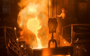 Picture fire, heat, sparks, molten metal, smelting factory worker