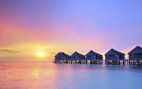 Picture ocean, water villas resort, sunset on Maldives island