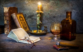 Picture glass, books, candle, cigar, A cosy corner