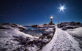 Picture winter, moonlight, lighthouse