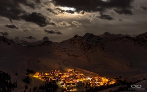 Picture winter, snow, mountains, night, lights, valley, settlement, lowland