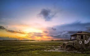 Picture field, machine, sunset