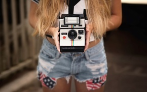 Picture shorts, camera, hands, Polaroid