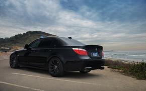 Wallpaper sea, the sky, clouds, black, shore, bmw, BMW, Parking, black, rear view, e60