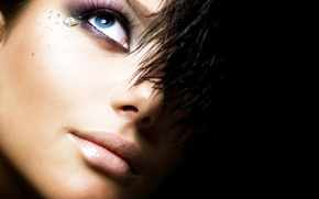 Picture girl, eyes, feathers, makeup, rhinestones, black background