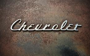 Picture the inscription, Chevrolet, rust, brand