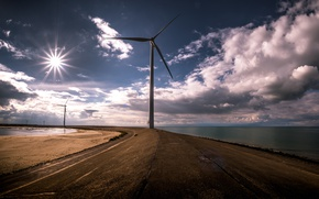 Picture sea, the sky, windmills