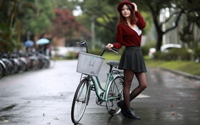 Picture girl, bike, the city