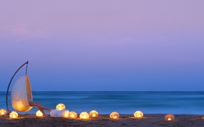 Picture beach, the ocean, chair, the evening, candles, legs