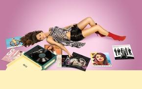 Picture look, pose, music, shorts, figure, actress, brunette, photographer, album, lies, player, vinyl, singer, boots, on …