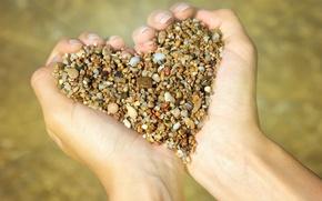 Picture heart, hands, pebbles