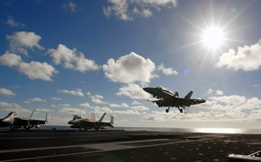 Picture the sun, clouds, fighter, the carrier, landing