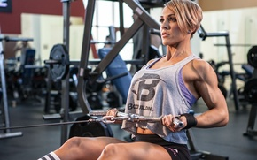 Picture legs, back, female, arms, bodybuilder, exercise machine