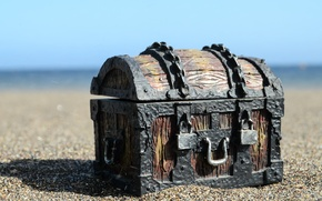 Picture metal, wood, sand, chains, locks, old treasure chest