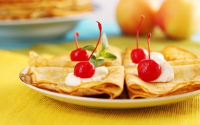 Picture cherry, pancakes, cream, mint leaves