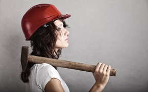 Picture woman, hammer, pearls, profile view