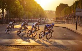 Picture racing, cyclist, through Paris, for Tour De France