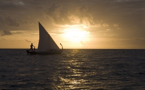Picture the sun, the ocean, boat, the evening, sail
