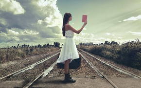 Picture girl, rails, railroad, suitcase, guide
