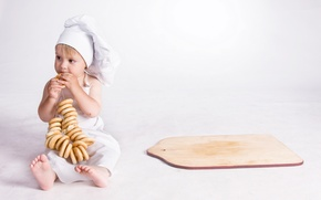 Picture kitchen, cook, bagels, Board, child, cap, apron, cap, cook, Child, kitchen, bagels, apron, ligament, cutting …