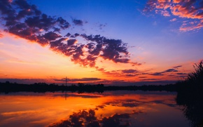 Picture clouds, sunset, river, contrast