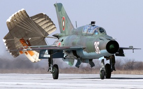 Picture parachute, landing, training front-line fighter with upgraded avionics, MiG-21УМ, braking, Fishbed