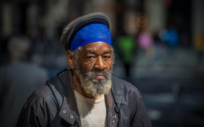 Picture man, bearded, direct gaze, homeless