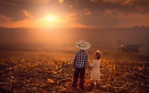Picture the sun, sunset, children, boy, horizon, girl, field.autumn
