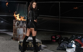 Picture look, fire, model, the fence, shorts, stockings, brunette, gloves, chest, knee, barrel, suitcases, leather jackets, …