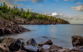 Picture the sky, clouds, trees, lake, stones, rocks, shore, horizon, USA, Minnesota