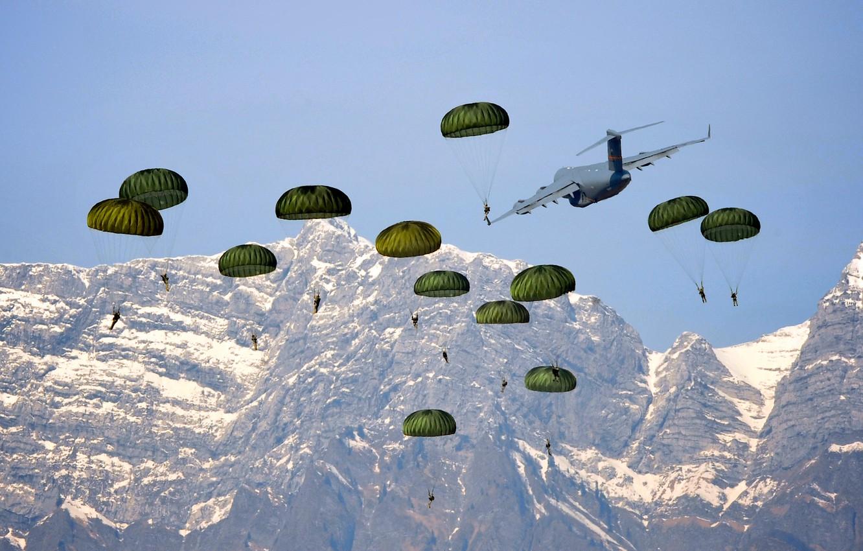 Photo wallpaper mountains, the plane, landing, skydivers
