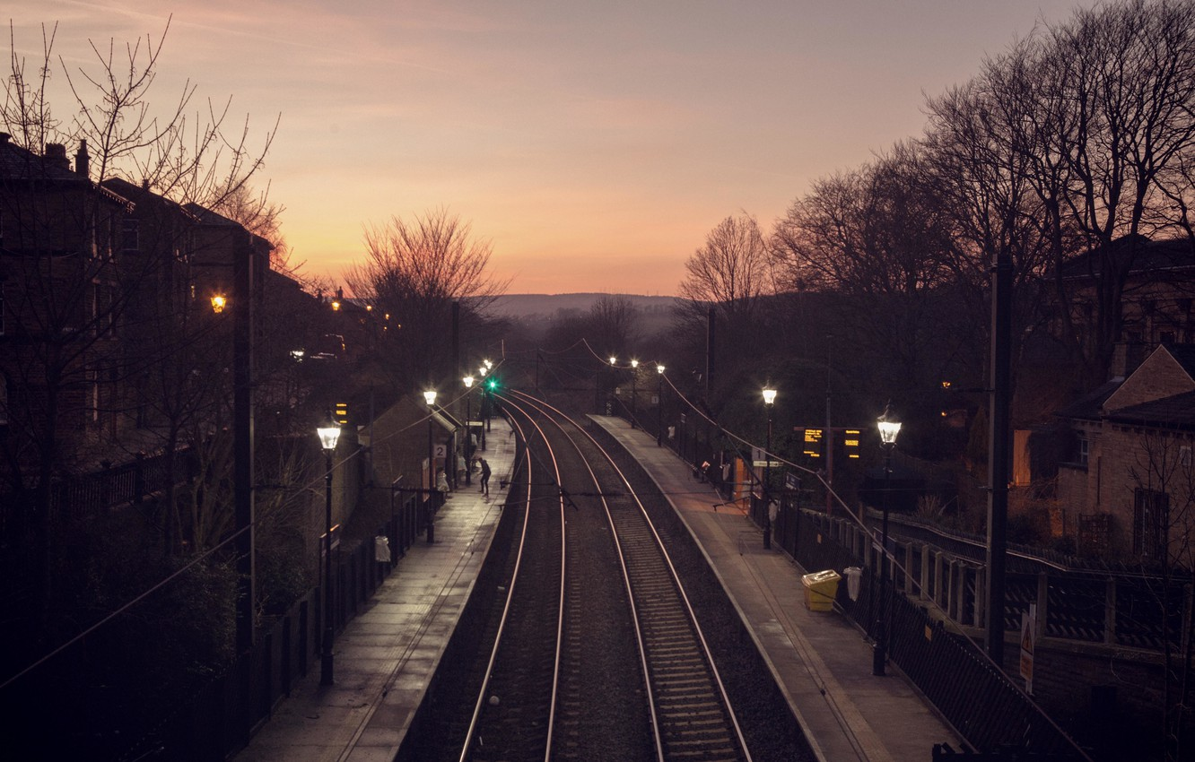 Photo wallpaper city, trees, station, people, hill, houses, dusk, railway, rails, silhouette, power line, lamp posts