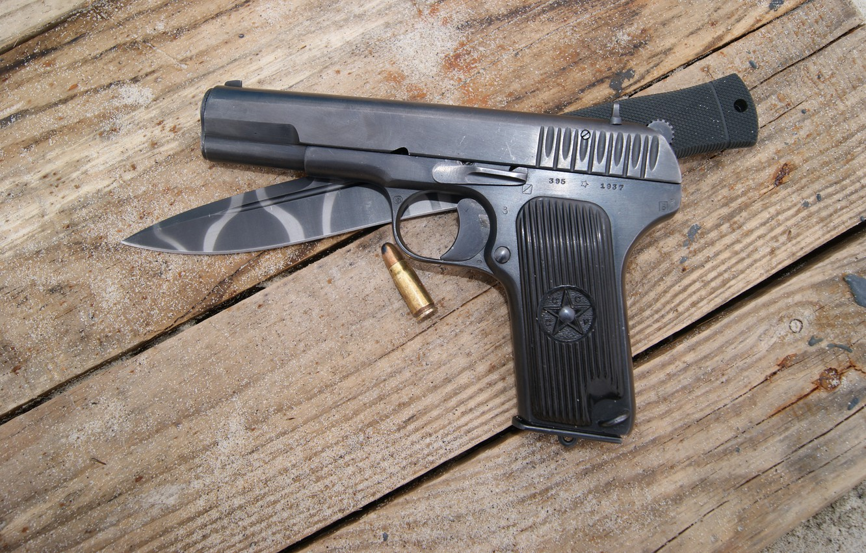 Photo wallpaper gun, knife, cartridge