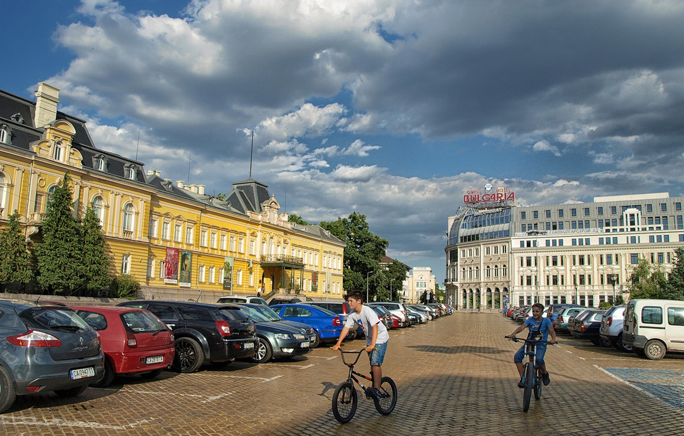 Photo wallpaper the sky, clouds, joy, children, street, area, cars, sky, cars, square, clouds, street, bikes, Bulgaria, …