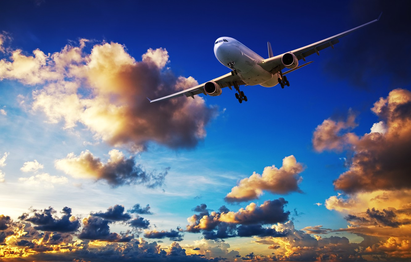 Photo wallpaper clouds, sunset, flight, flies, in the sky, passenger, airliner