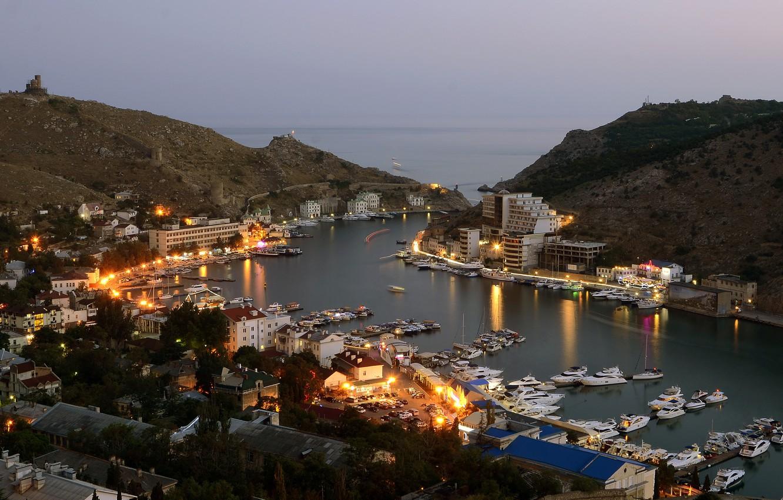 Photo wallpaper sea, the city, lights, building, home, boats, the evening, lights, twilight, Ukraine, Crimea, Balaclava