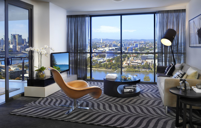 Photo wallpaper sofa, lamp, chair, TV, window, table, living room, the city.