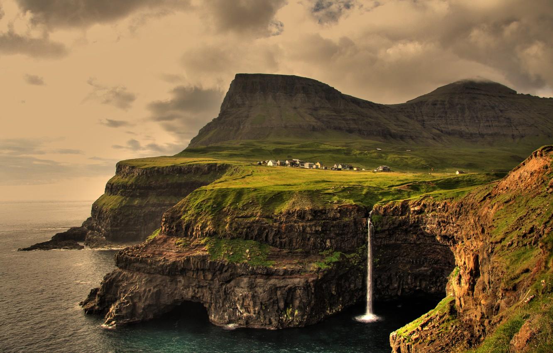 Photo wallpaper the sky, clouds, sunset, mountains, rocks, waterfall, village, on the edge, The Atlantic ocean, Faroe …