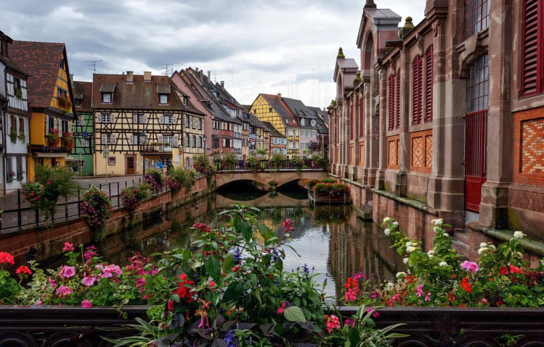 Photo wallpaper the sky, flowers, bridge, France, home, channel, Colmar, Fachwerk