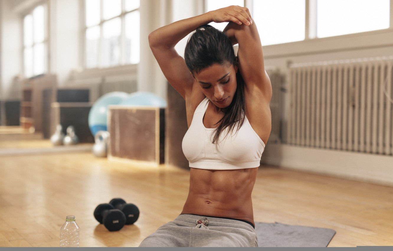 Photo wallpaper brunette, pose, fitness, arm, stretching, sportswear