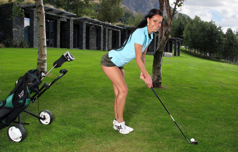 Photo wallpaper field, grass, girl, trees, smile, feet, shorts, the ball, brunette, shirt, legs, stick, Golf, melissa, …