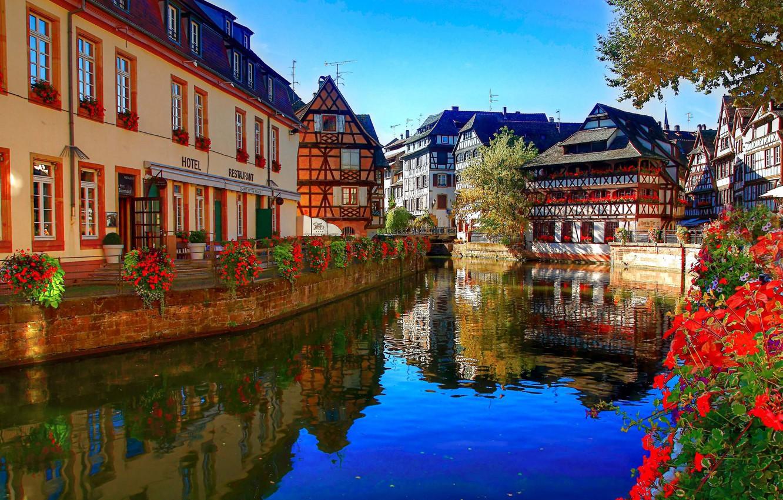 Photo wallpaper flowers, river, France, building, home, channel, restaurant, the hotel, architecture, Strasbourg, France, Strasbourg