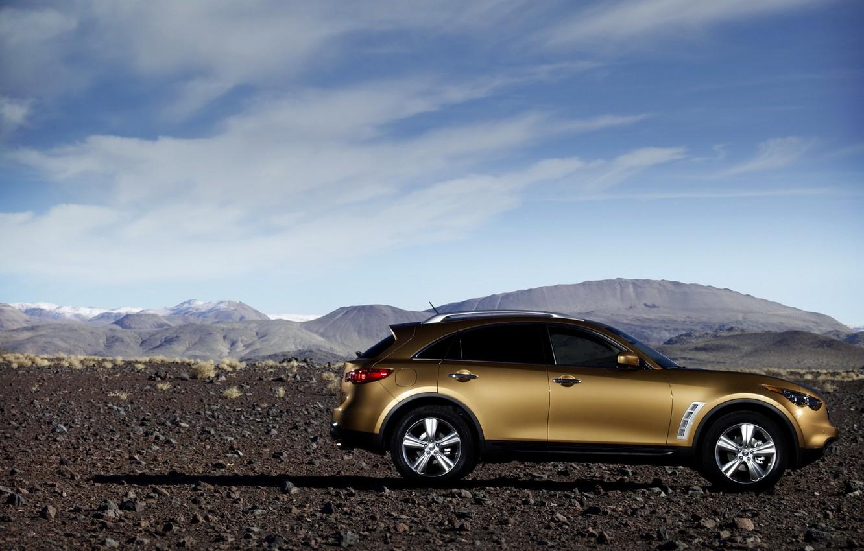 Photo wallpaper sand, the sky, clouds, mountains, the dunes, stones, desert, shadow, orange, door, drives, side, infiniti, …
