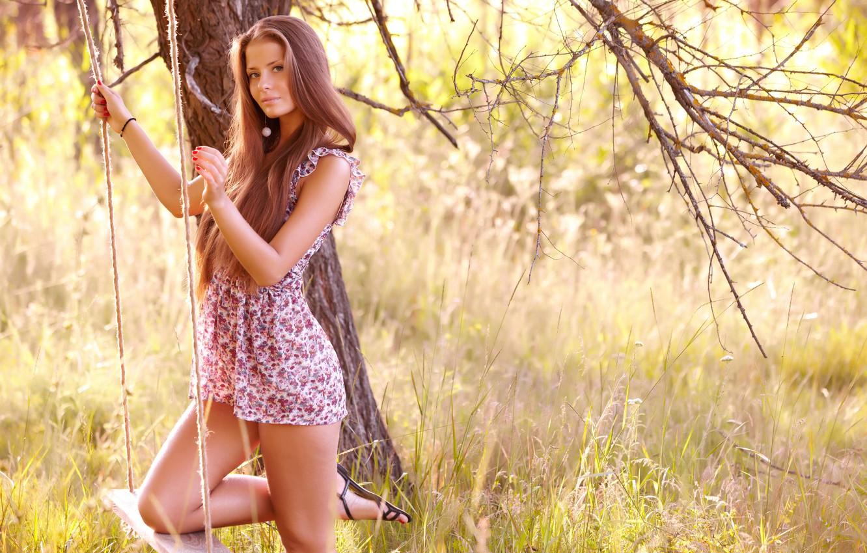 Photo wallpaper forest, grass, look, girl, swing, tree, dress, brown hair, legs, jasmine