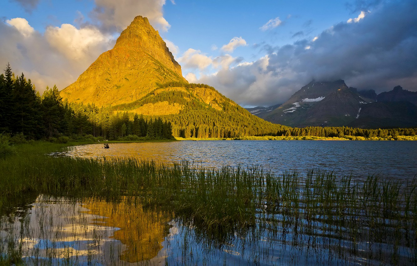 Photo wallpaper forest, grass, the sun, clouds, trees, mountains, lake, the reeds, rocks, USA, Glacier National Park, …