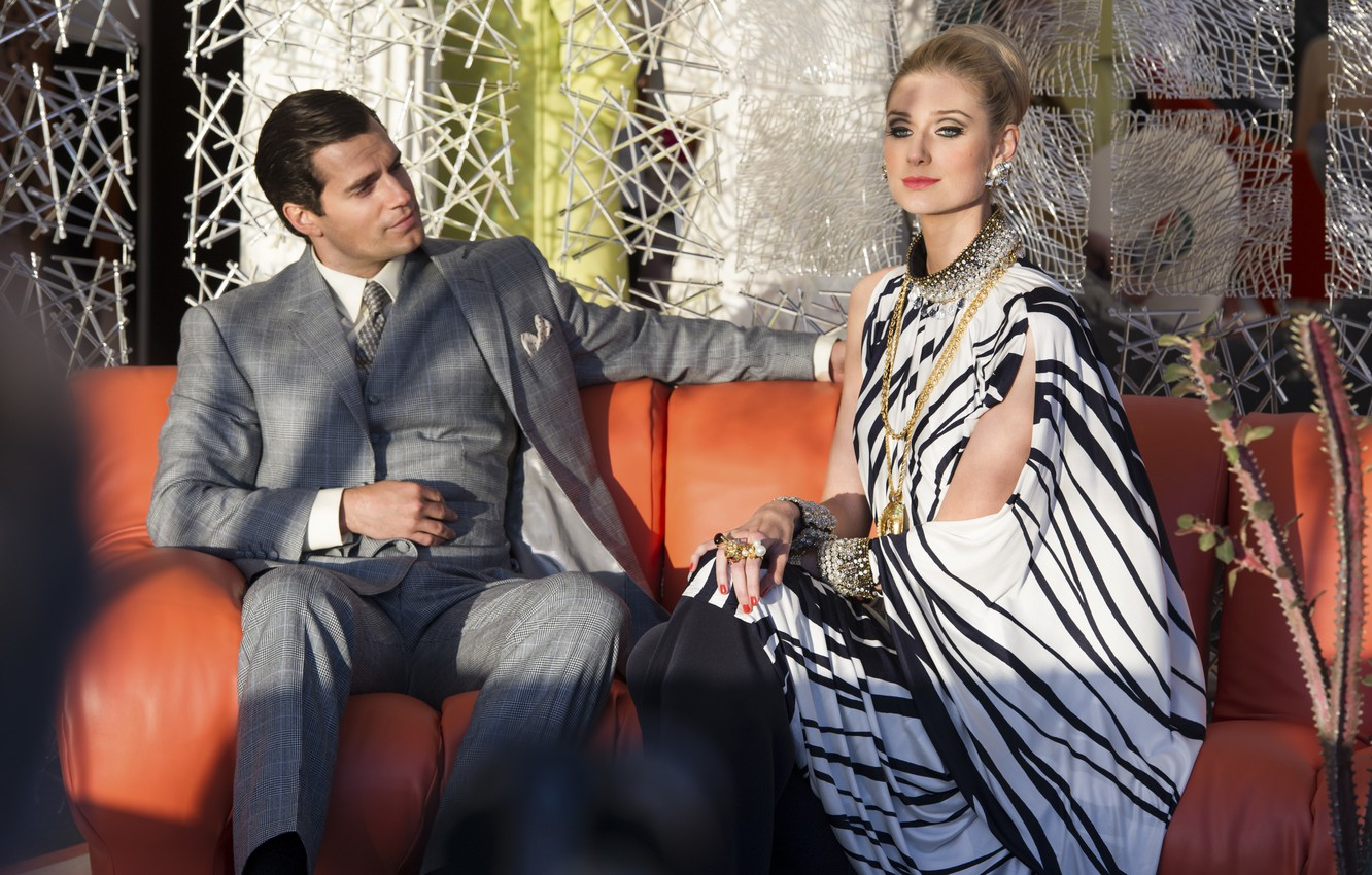 Photo wallpaper on the couch, sitting, Henry Cavill, Henry Cavill, Elizabeth Debicki, Elizabeth Debicki, Agents A. N. …