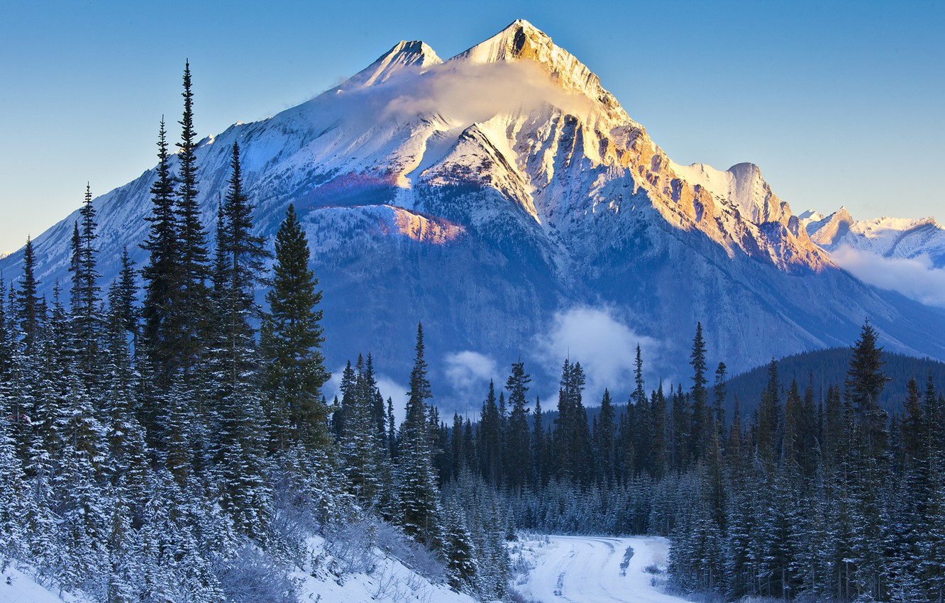 Photo wallpaper road, the sky, snow, trees, sunset, mountains, spruce, slope, Banff National Park, Alberta, Canada