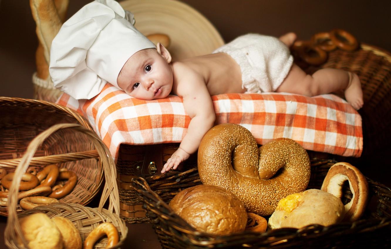 Photo wallpaper children, baby, bread, lies, bagels, bread, child, cap, tablecloth, bagels, Anna Levankova, scullion, pretzel