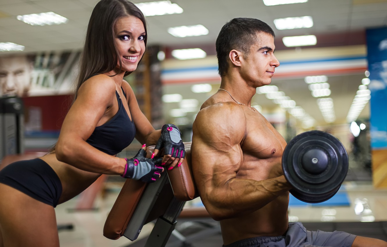 Photo wallpaper woman, muscles, look, pose, smiling, fitness, training, dumbbell, Herculean arm