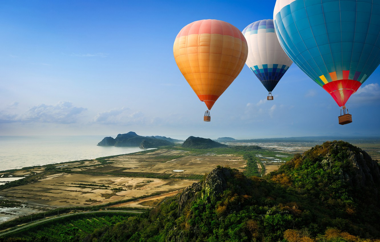 Photo wallpaper road, sea, mountains, balloons, hills, shore, view